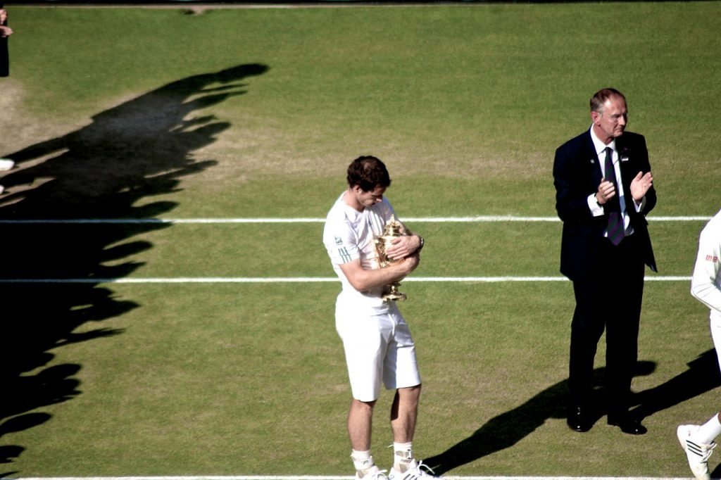 Murray clutching the Wimbledon trophy in 2013